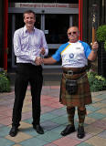 The Queen's Baton arrives at The Hub, on its way to Edinburgh Castle