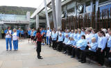 The Queen's Baton emerges from The Scottish Parliament in front of a choir singing in Gaelic