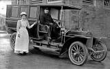 Photograph taken in 1907  -  Nurse Miss Mary Barrie Scott standing beside what is said to  be Einburgh's first motorised ambulance