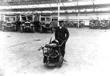 Central Garage, Annandale Street  -  Man with a starting handle machine and buses in the background