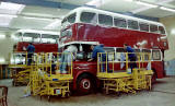 Two buses, one a Leyland Titan PD2 being painted at Seafield Paintshop