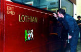 Gold Line being applied to one of the Lothian Buses at the Paintshop at Seafield.