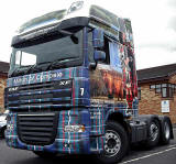 Truck decorated with photos, including my photograph of highland cow