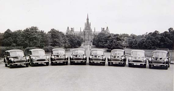 Morris Minors bellonging to Edinburgh Corporation parked in front of Fettes College  -  Photograph probably taken in the 1950s