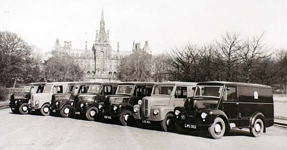 Trojan Vans belonging to Edinburgh Corporation parked in front of Fettes College  -   photographed probably in the 1950s