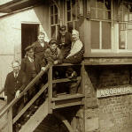 Six railway workers on the steps of Woodmuir Junction Signal Box in West Lothian