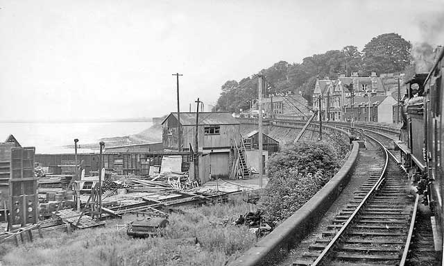 Railway photos  -  A tour train from Granton passes the boatyard at the end of Granton Eastern Breakwater  -  August 31, 1963
