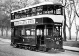 Tram 230 posed for a photograph.  Was this photo taken at Bruntsfield Links or The Meadows, and when might this photo have been taken?