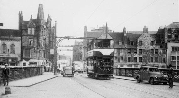 Commercial Street, Leith  -  A tram crosses the bridge over the Water of Leith, heading towards Newahven and Granton.