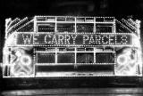 Illuminated Tram  -  We Carry Parcels