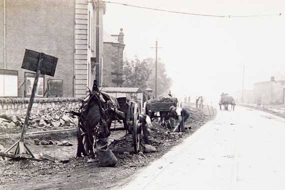 Work, probably in connection with laying or removing tramway tracks.  Can anybody tell me where or when this photograph  may have been taken?