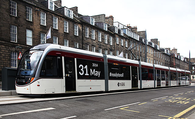 Tram in York Place in early-March 2014, announcing the date when the Edinburgh tram service will commence