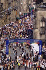 Crowds gather at the Royal Mile to watch the street theatre during the Edinburgh Festival in August 2003