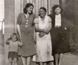 A young boy and three ladies at East Thomas Street, around 1940