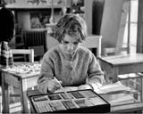 Challenger Lodge  -  6-year-old Gillian mastering arithmetic by the Cusenaire System  -  Photograph published in 'The Scotsman', February 8, 1959