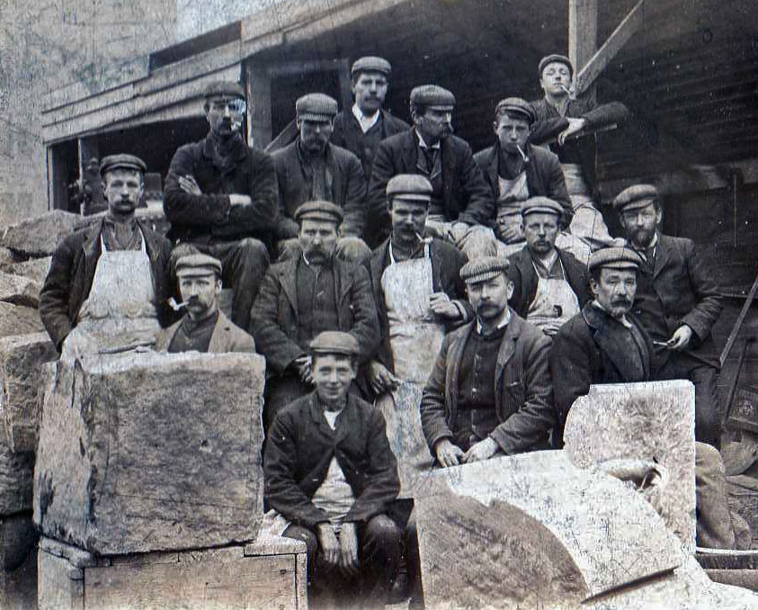 Alexander Sim Milne with his stonemason mates sitting in Colin MacAndrew's Yard.