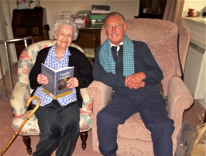 Allan Dodds (former pupil at George Heriots Primary School) sitting beside his former teacher, Agnes Hamilton