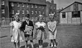 4 children in the grounds of Granton Primary School, 1955
