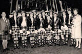 Jean Carnie's Leith Ladies Pipe Band and coach