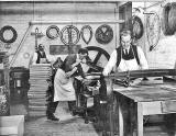 Lady Haig's Factory at the Canongate:  Men working, one on the guillotine