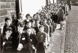 Pupils from Leith Walk Primary school queue up at Abbeyhill station in 1961 to catch the TV Excursion Train around Central Scotland.