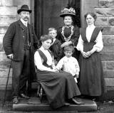The first family at Kirkgate, Liberton on the doorstep of their house, around 1908