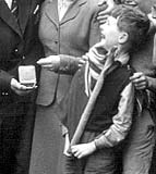 Bill Cunningham, one of a group of local residents in Lyne Street, Abbeyhill, welcoming home Jackie Brown from the Empire Games with his Boxing Medal