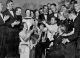 A Trumpeter from the Band at the Palais de Danse, surrounded by a group of 20 Dancers, 1935