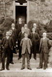 Ten men on the steps, wearing waistcoats and pocket watches  -  Who?  When?  Where?