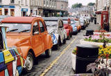 Citroen 2CVs in the centre of Kelso in the Scottish Borders  -  during the World 2CV Meeting held at Kelso, July 2005