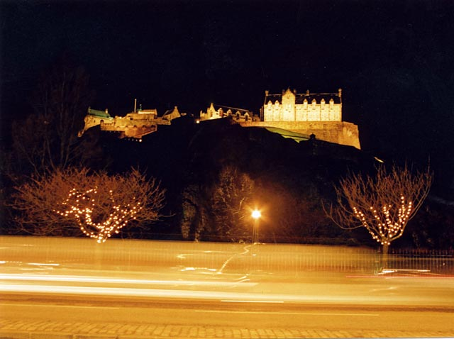 Edinburgh Castle and Christmas Lights on the trees in West Princes Street Gardens