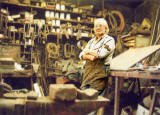Alexander McLennan with his hammer, in the middle of his blacksmiths workshop at Powderhall