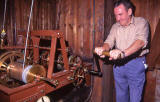 Ritchie  -  The clock winder winding the clock at the Highland Tollbooth church - 1992