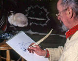 Saxe Shaw, using a quill to draw his cat