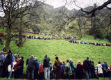 The Easter Play in West Princes Street Gardens  -  26 March 2005  -  The audience lines the paths on Castle Rock, awaiting the Crucifixion scene.  Edinburgh Castle is in the background.