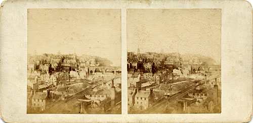 Stereo view by McGlashon  -   looking from the Burns' Monument in Regent Road, over the railway line at Waverley towards Edinburgh Castle.