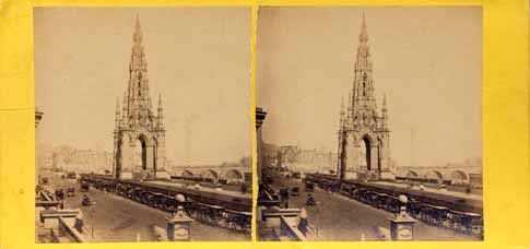 GW Wilson stereo card - The Scott Monument and a line of coaches in Princes Street