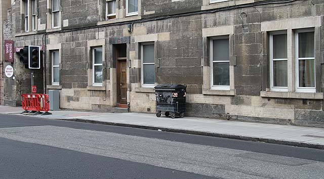 Section of Gorgie Road photographed in 2010.  This is the same section as appeared in a photograph of  a St Cuthbert's horse-drawn milk delivery cart, 1971