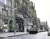 High Street  -  looking to the east from the junction with South Bridge.  Street lights are mounted on the wall