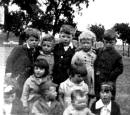 Photograph of children from  Holyrood Square, Dumbiedykes, Edinburgh, provided by Isa Paulin, Cheshire, one of the children in the photo.