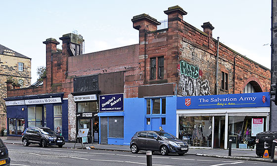 Shops at No.99 to No. 109, Leith Walk, photographed in August 2014.  No.109 Leithj Walk was the address of Giibson's Aeroplane Works in 1910