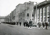 1st Leith Boys' Brigade Company march passes under the railway bridge beside Jane Street, near the foot of Leith Walk