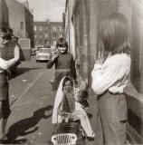 Fiona Logan with her sister Julie and brother Malcolm playing at getting married, at Murano Place, around 1968
