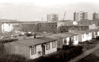 Oxgangs Avenue  -  Prefabs in the foreground and high-rise flats in the background.