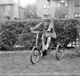Douglas Roberts on his tricycle in his garden at Pilton Avenue  -  early-1950s