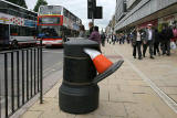 Cone in a litter bin at Princes Street, opposite the foot of the Mound