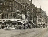 Photograph by Norward Inglis  -  A procession along Princes Street approaches the salute at Hanover Street  -  early-1950s