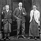 Otto Goll and 2 other men outside his Hairdressing Saloon, Raeburn Place, Stockbridge, Edinburgh