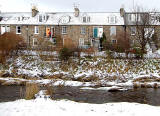 Looking east across the Water of Leith to Stockbridge Colonies, Reid Terrace from Arboretum Acenue  -  December 2009