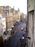 View from a 4th floor room in the High Street almost opposite John Knox House, looking east down the Royal Mile towards Holyrood Palace